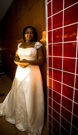 Gorgeous: Bride against red tiled background